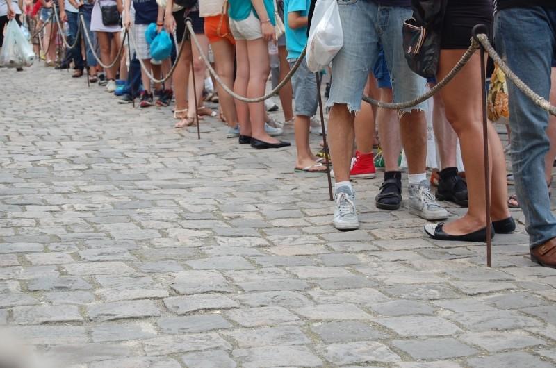 people-foot-waiting-line-queue-crowd-street